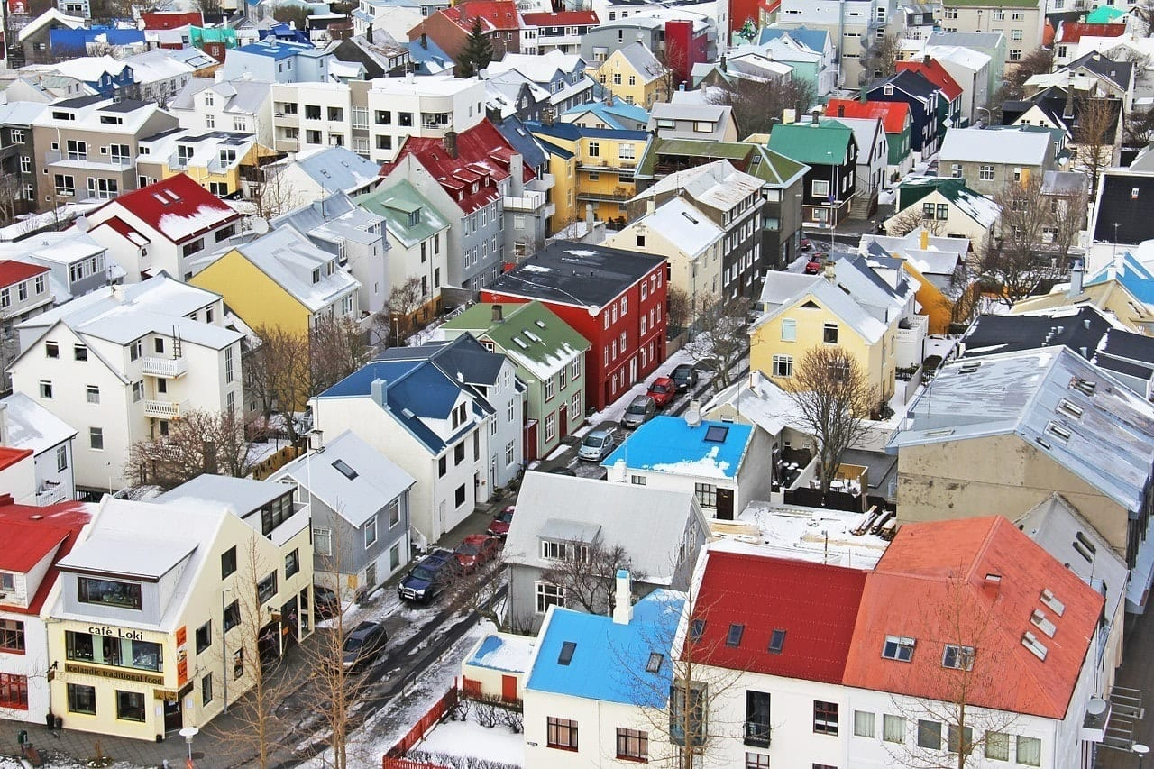 Colorful roofs and houses on the gridded streets of Reykjavik, Iceland, shot from above.