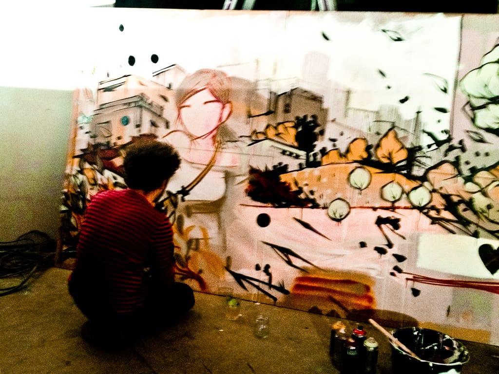 Artist at work at Generator Hostel