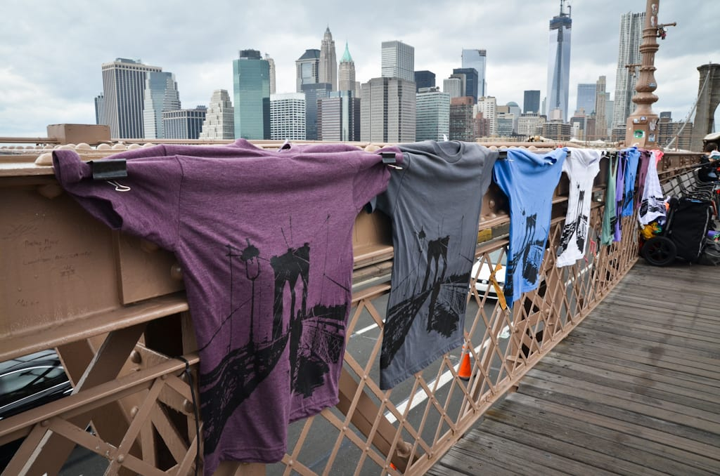 Shirts on the Brooklyn Bridge, with the outline of the bridge on them.