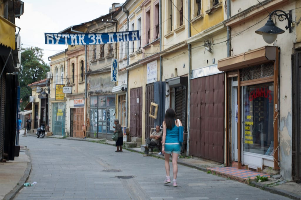 A woman walking past the old bazaar in Bitola, North Macedonia