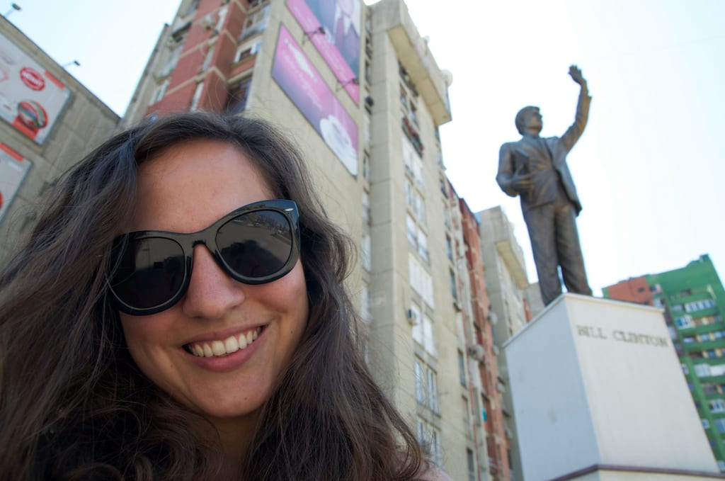 Kate takes a selfie at the Bill Clinton statue in Kosovo.