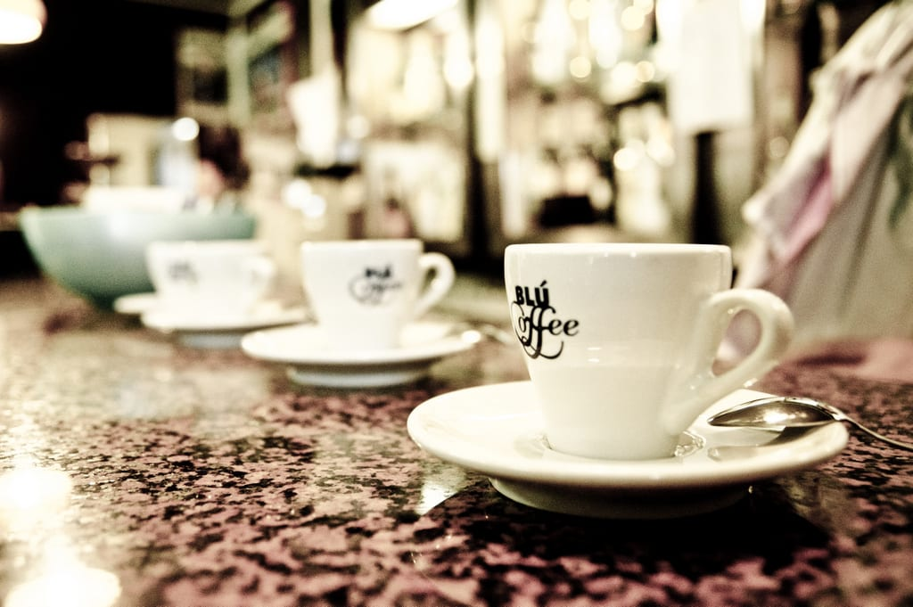 Rows of espresso cups on a counter in an Italian cafe.