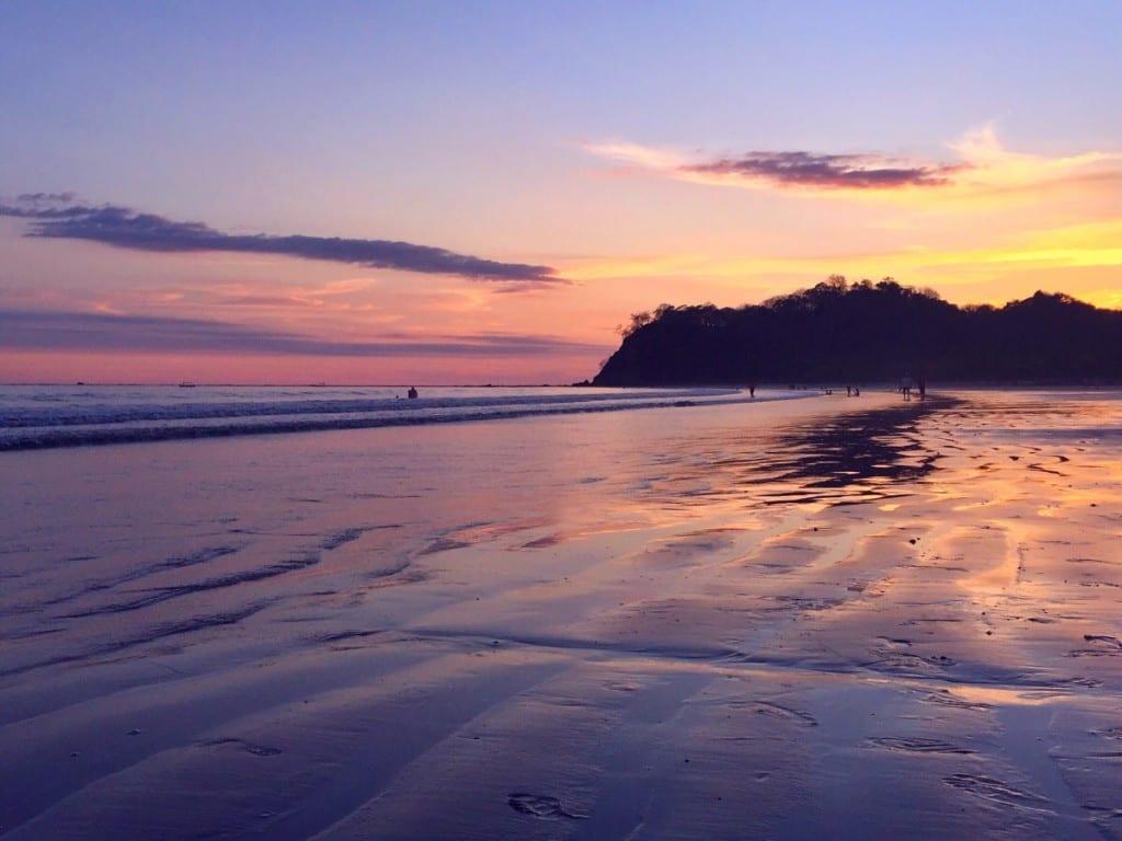 Purple and yellow sunset on the beach in Samara, Costa Rica.