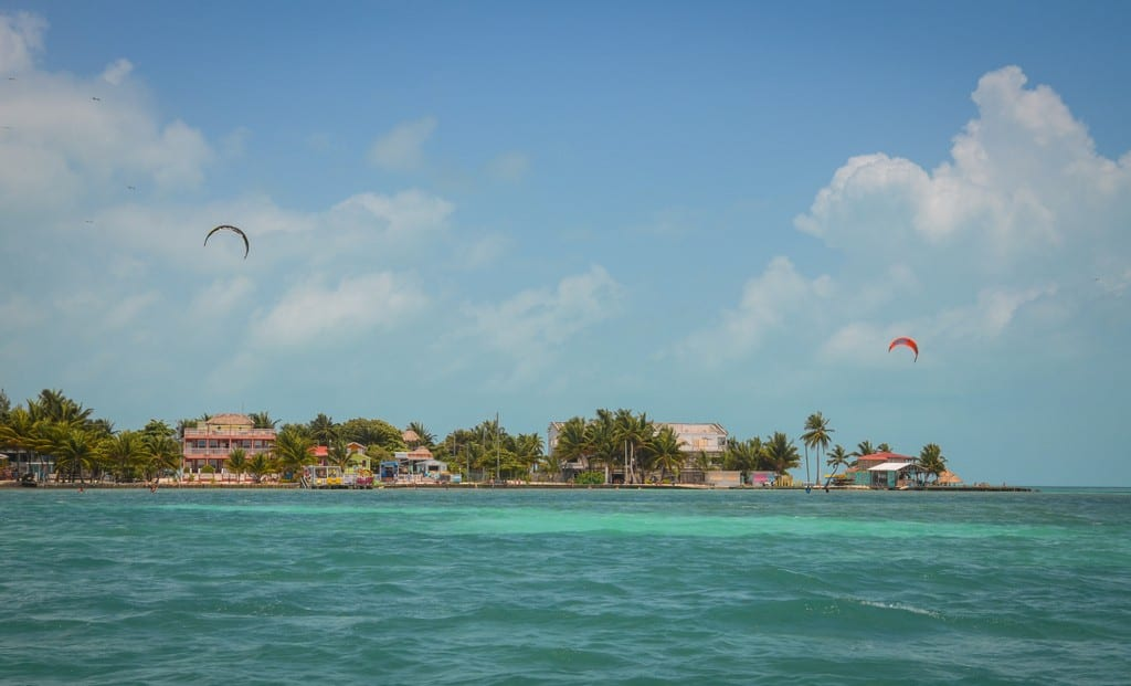 Caye Caulker island fro a distance, a kite in the air.