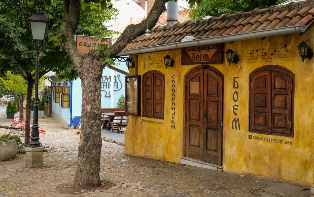A yellow house on a cobbled street in Belgrade
