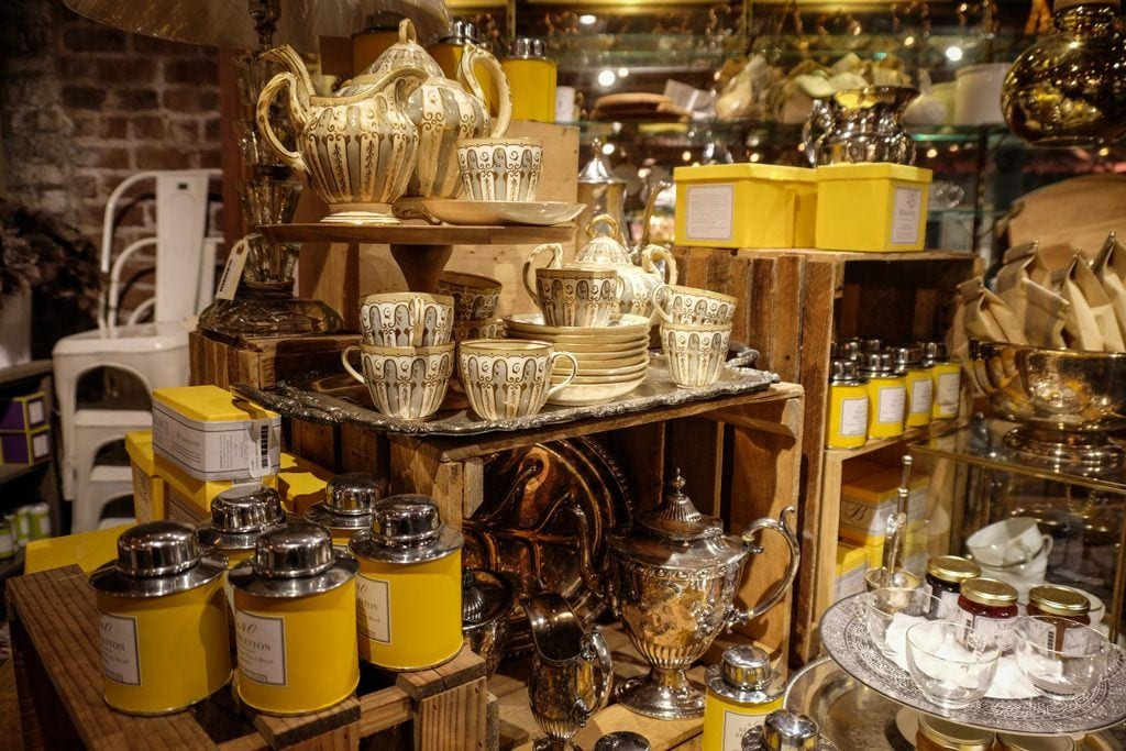 Rows of yellow cups, housewares, and accessories at the Paris Market.