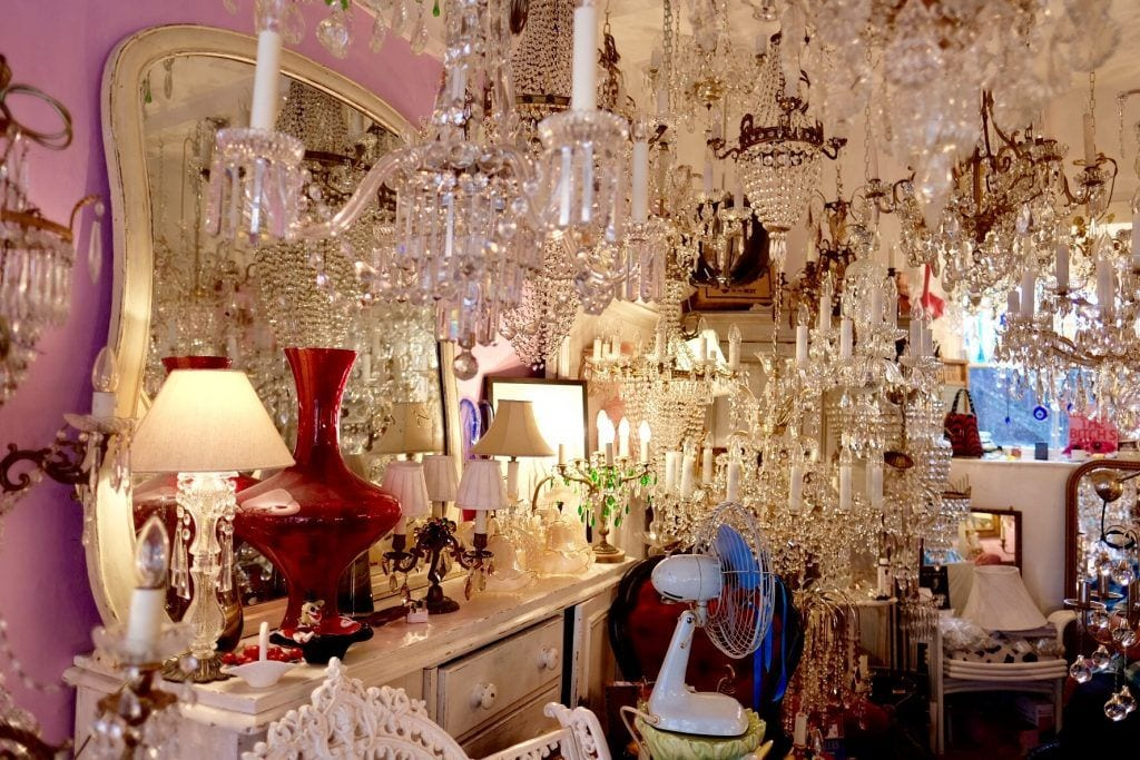 A store full of crystal chandeliers hanging from the ceiling.