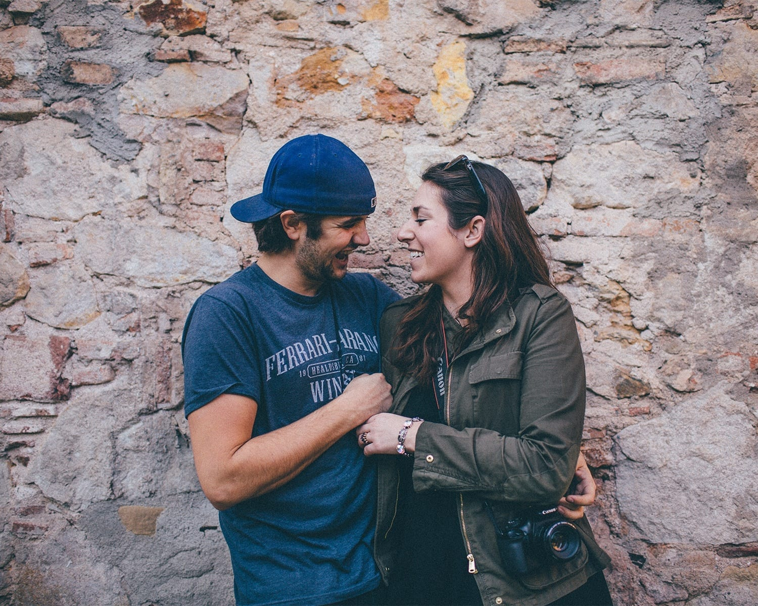 Ashley and Alex of In Pursuit of Adventure, smiling with their arms around each other.