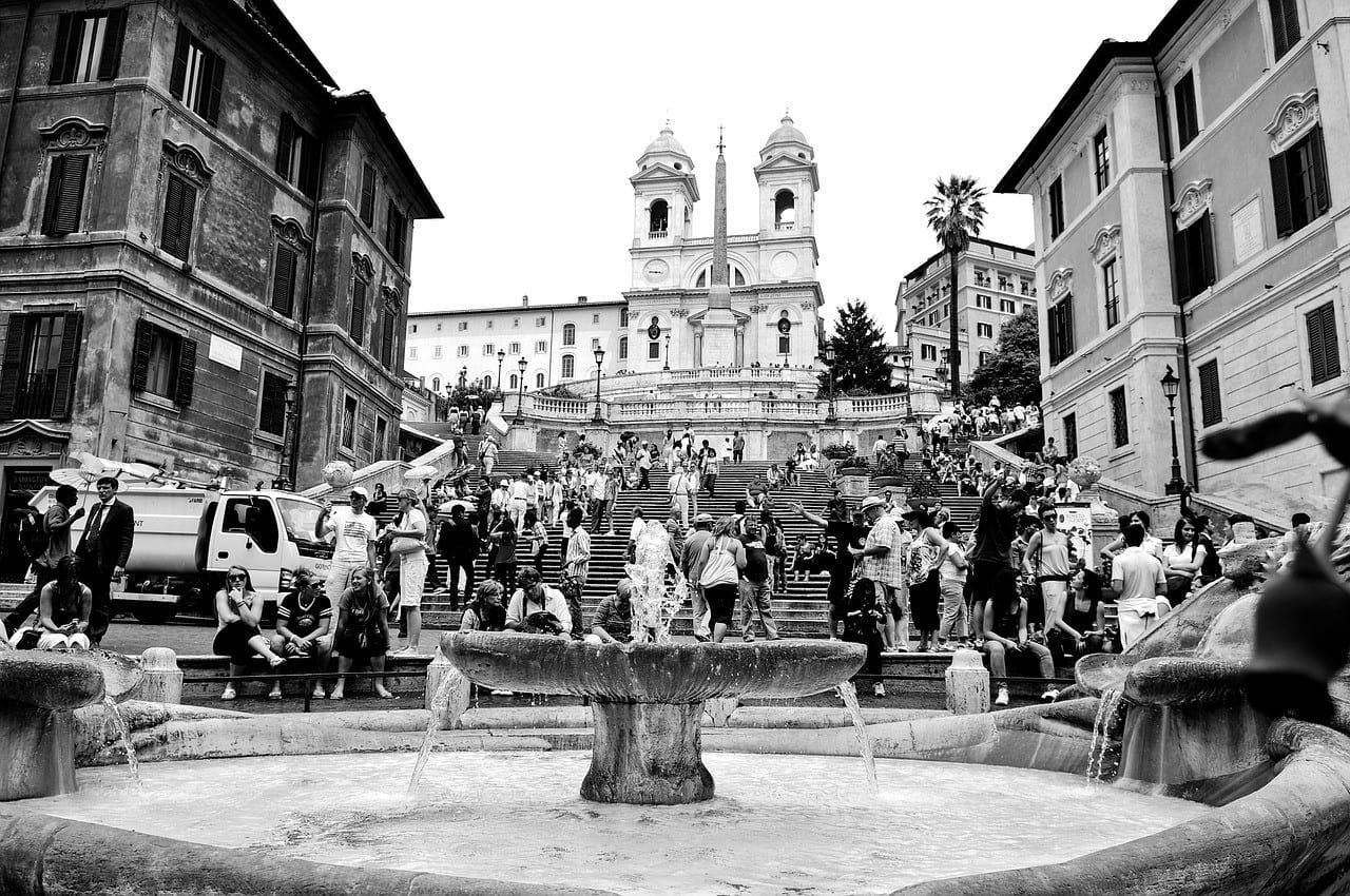 Crowds of people climbing up the Spanish Steps in Rome.