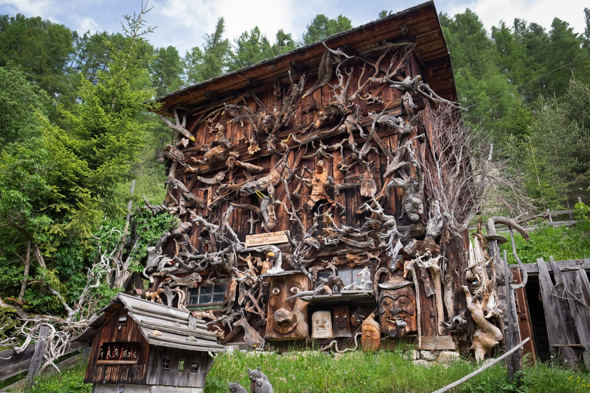 A wooden home in the Dolomites is covered with hundreds of wooden cutouts made from found pieces of wood.