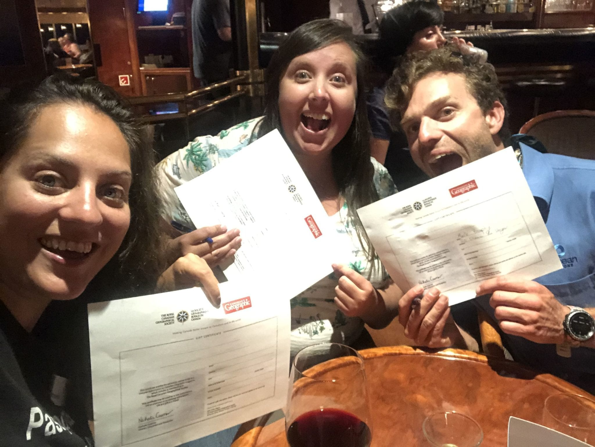Kate, Brophy, and Cailin hold their certificates for winning the trivia competition, and their free subscriptions to Canadian Geographic magazine.