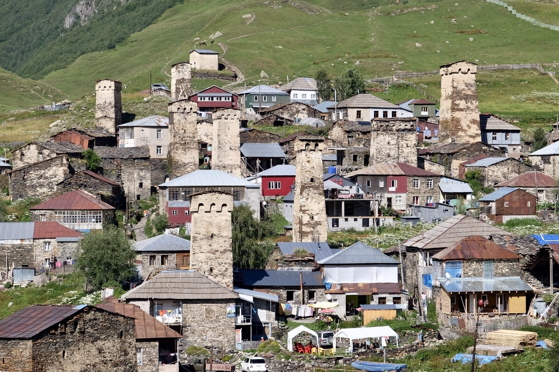 Close-up on medieval stone towers and other buildings in Ushguli, Georgia.
