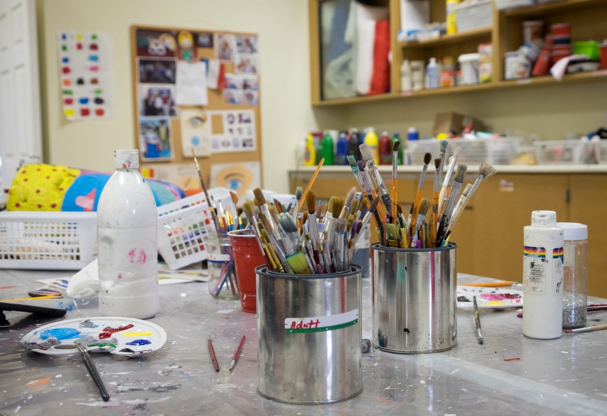 Paintbrushes on a table at the Mi-Careme Centre.