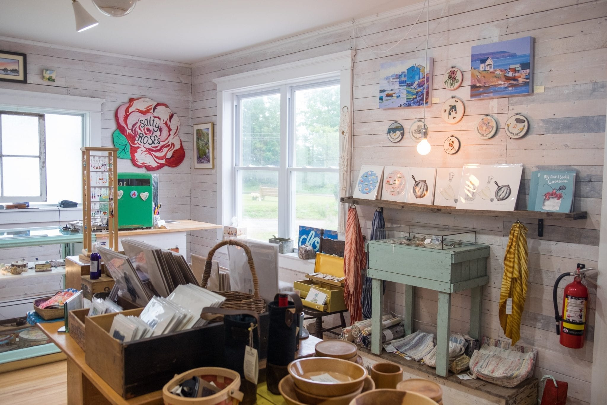 A light-filled room filled with local prints and jewelry in Cape Breton.