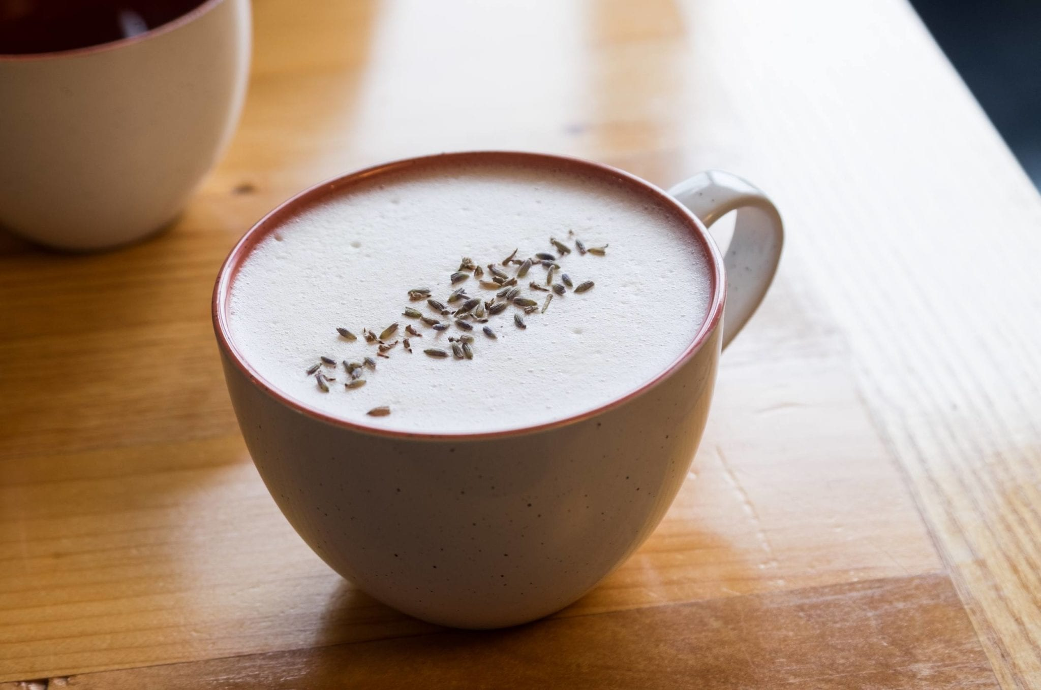 A latte topped with lavender seeds (which are not tasty).