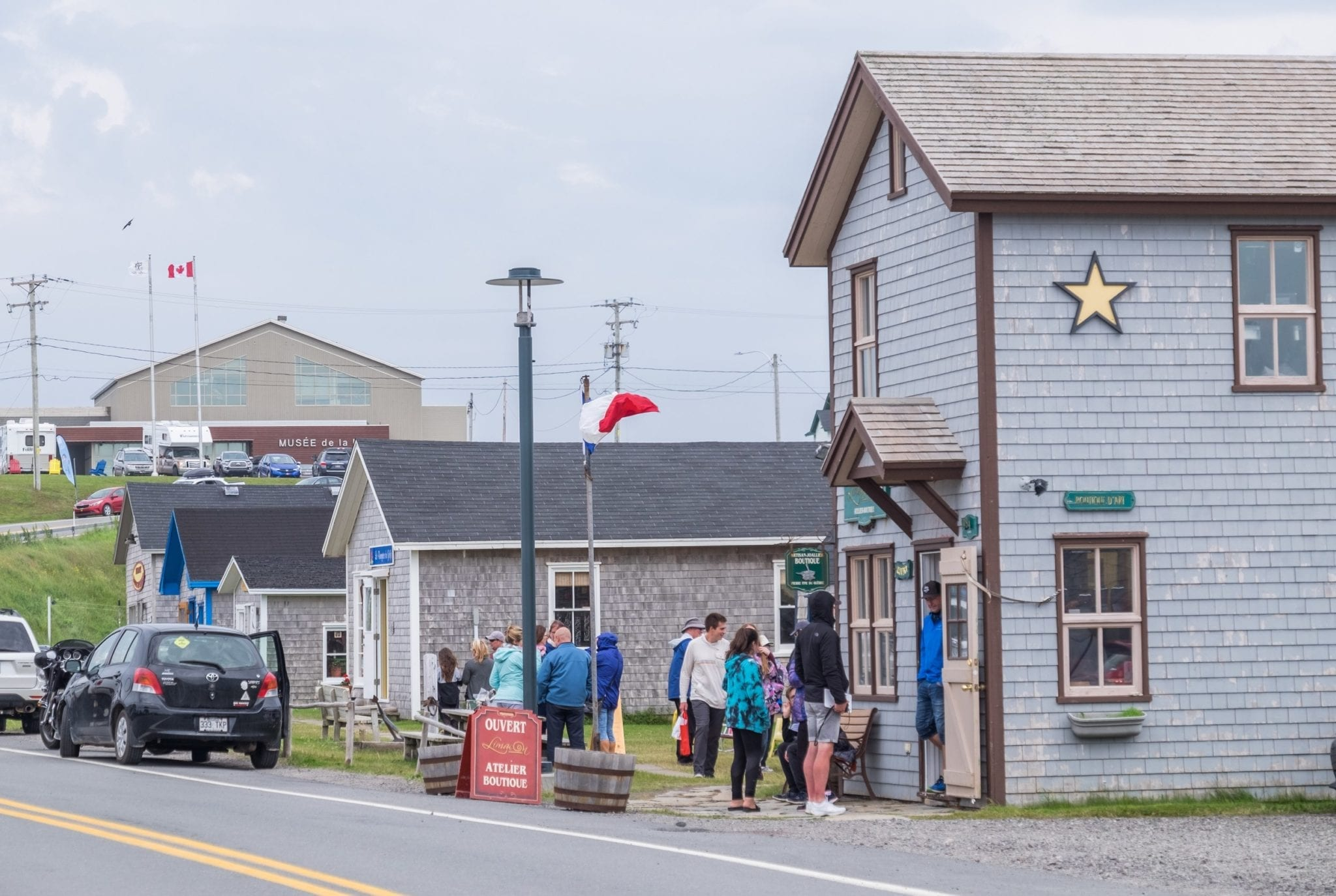 Gray houses and boutiques lined up in rows in the Iles-de-la-Madeleine.