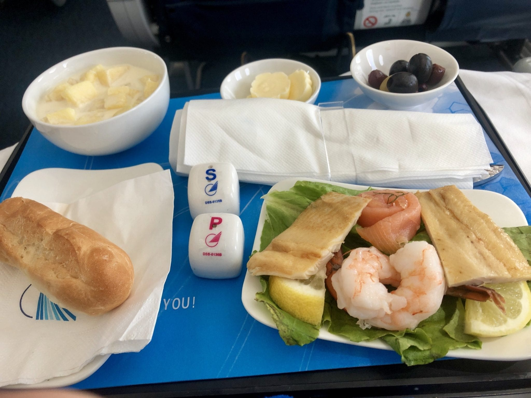 The appetizer on Azerbaijan Airlines: shrimp and cured seafood, pineapple in milk (weird), bread, berries.
