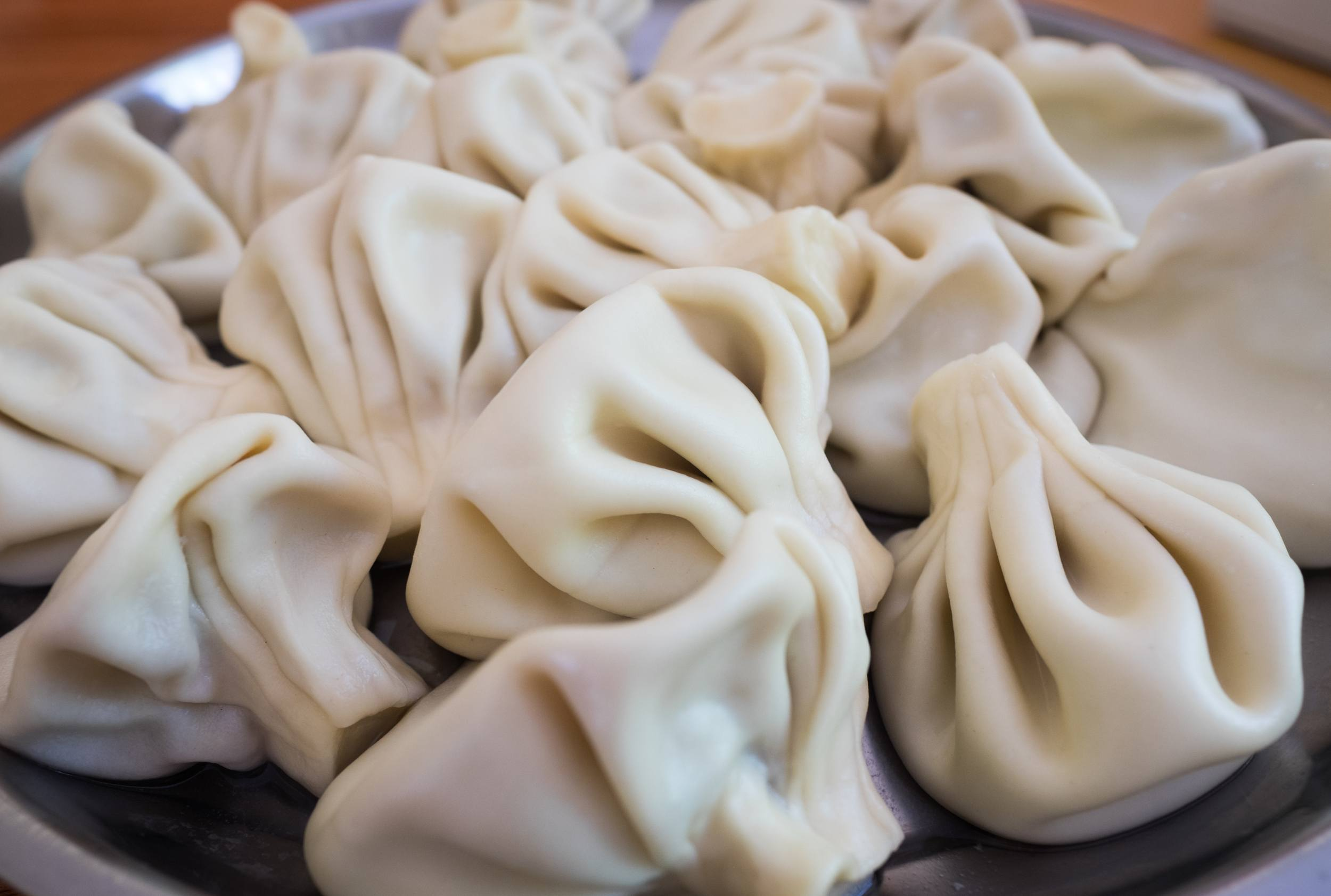 A plate piled with large khinkali, or Georgian dumplings.