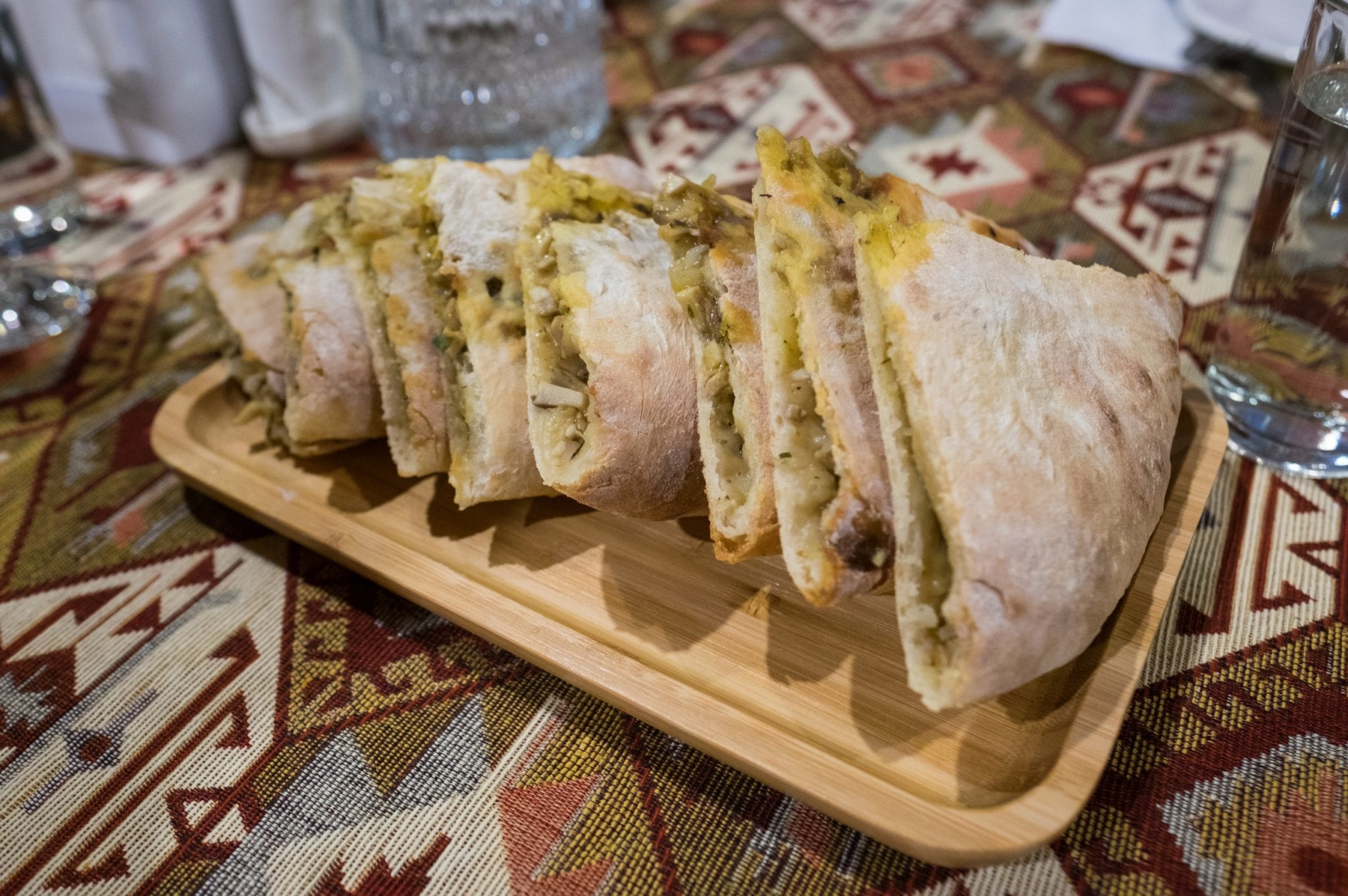 A plate of sliced Svaneti meat-stuffed bread.