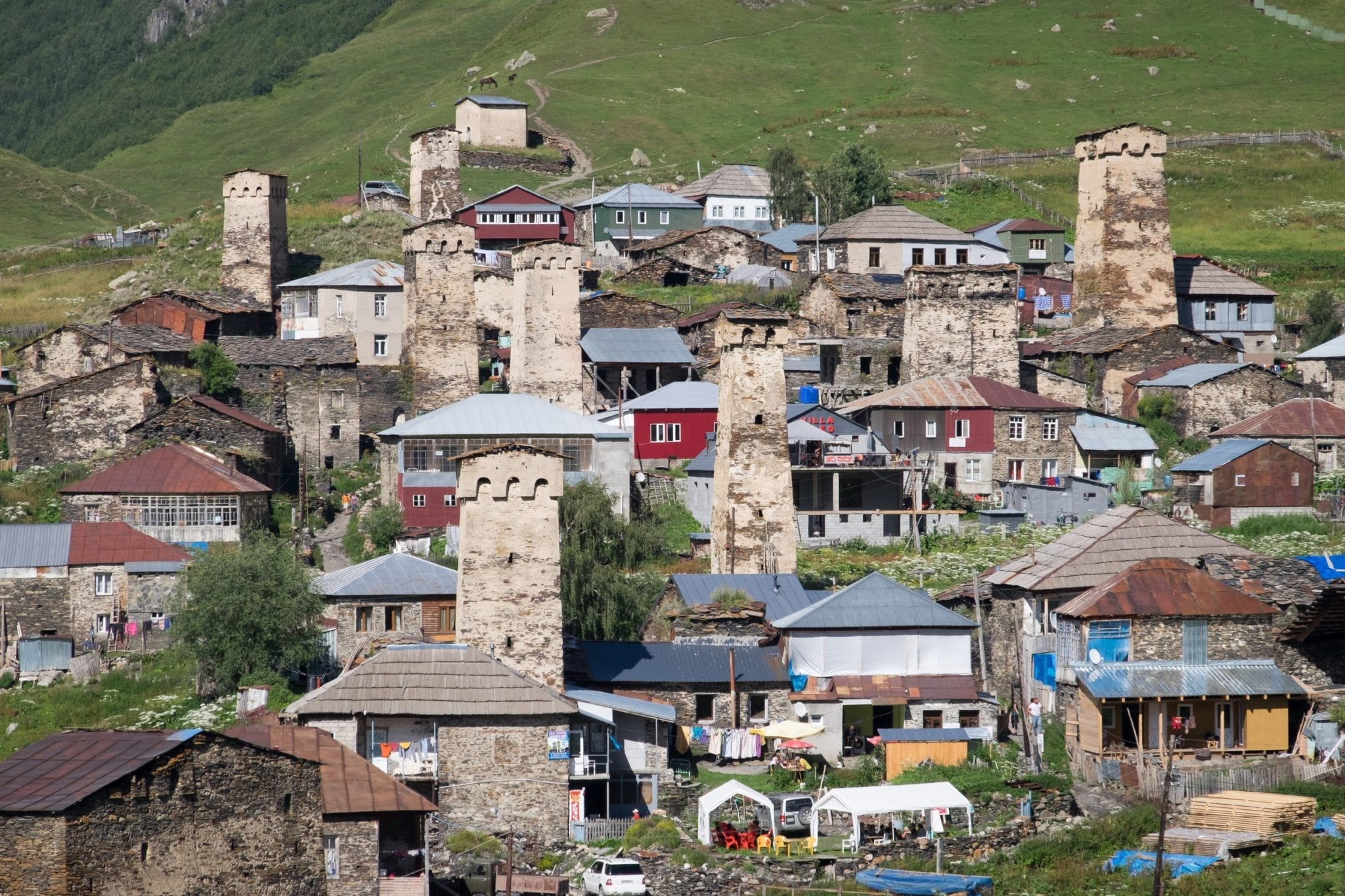 A close-up view of Ushguli's stone towers and village cafes.