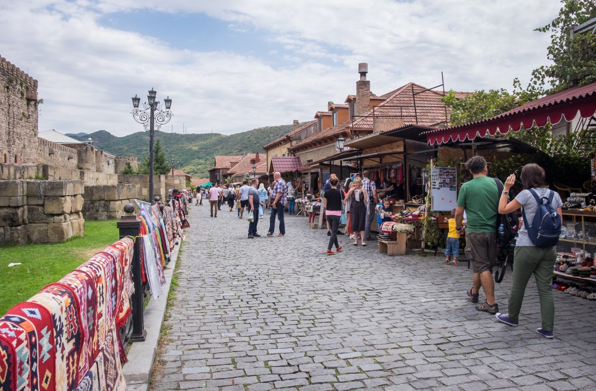 Small kiosks along a cobblestone path in Mtskheta, Georgia.