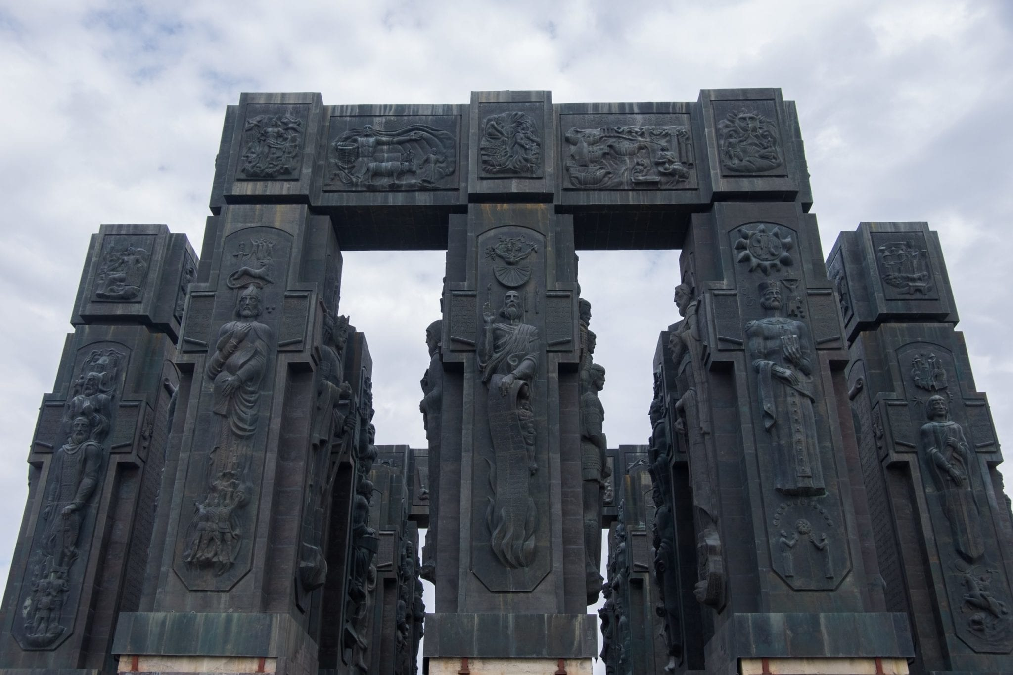 The Chronicles of Georgia: giant black pillars covered with carvings of people.