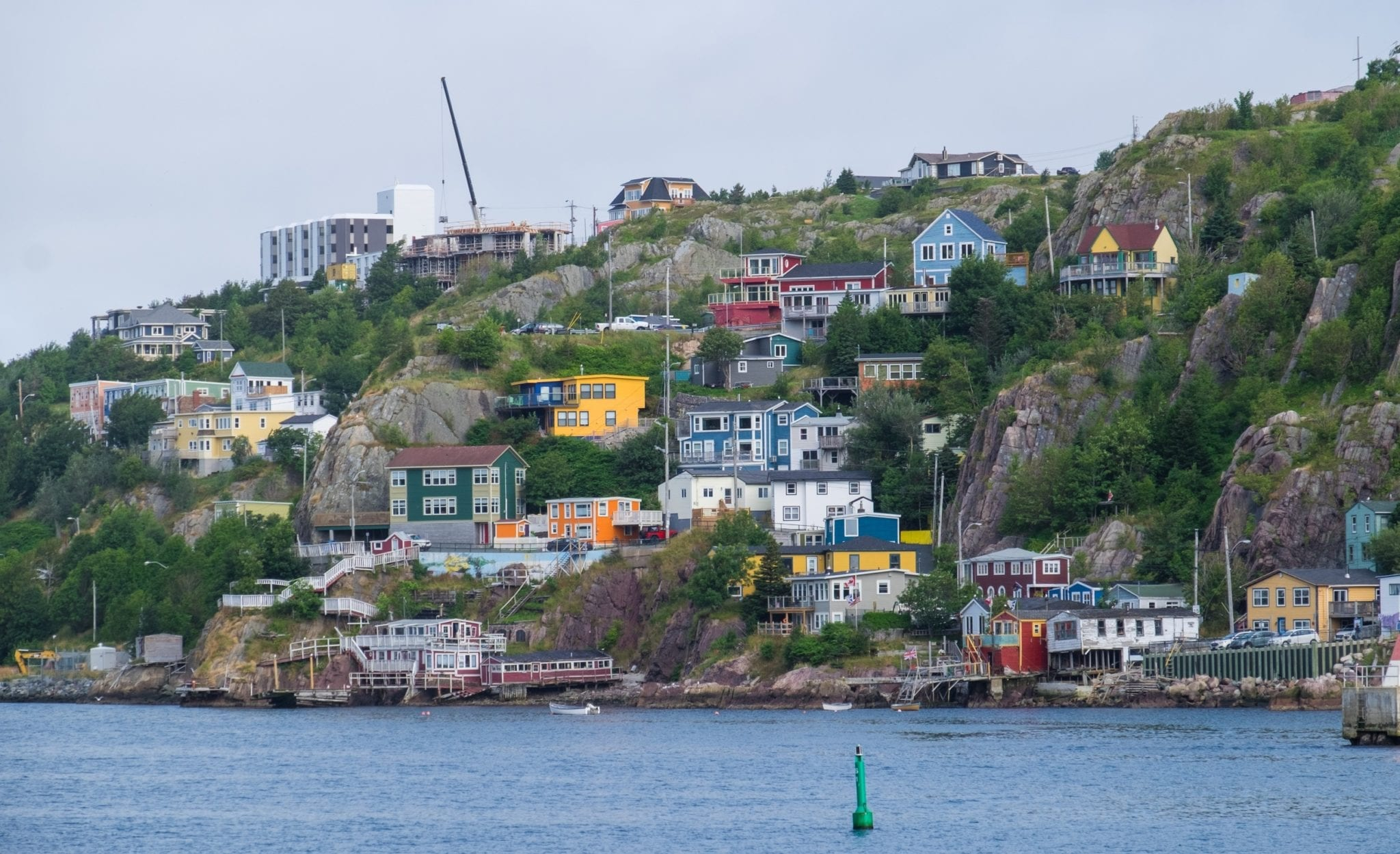 The same cottages on the harbor, but bright neon and full of life.
