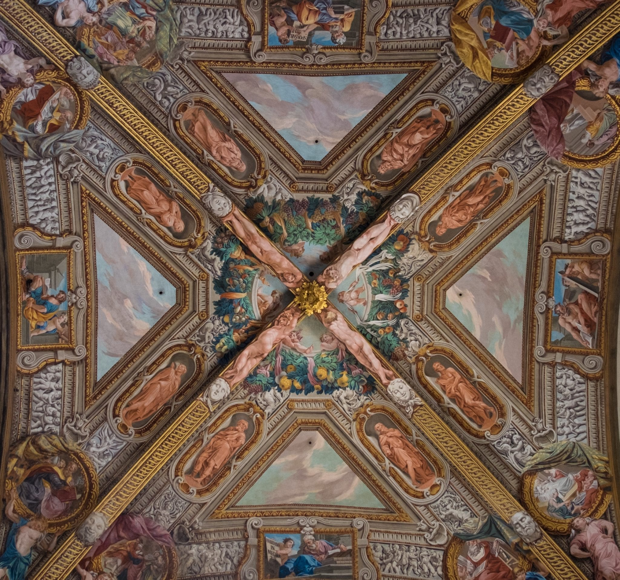 A square image of Parma's cathedral ceiling divided into sections shaped like an X, paintings on the ceiling.