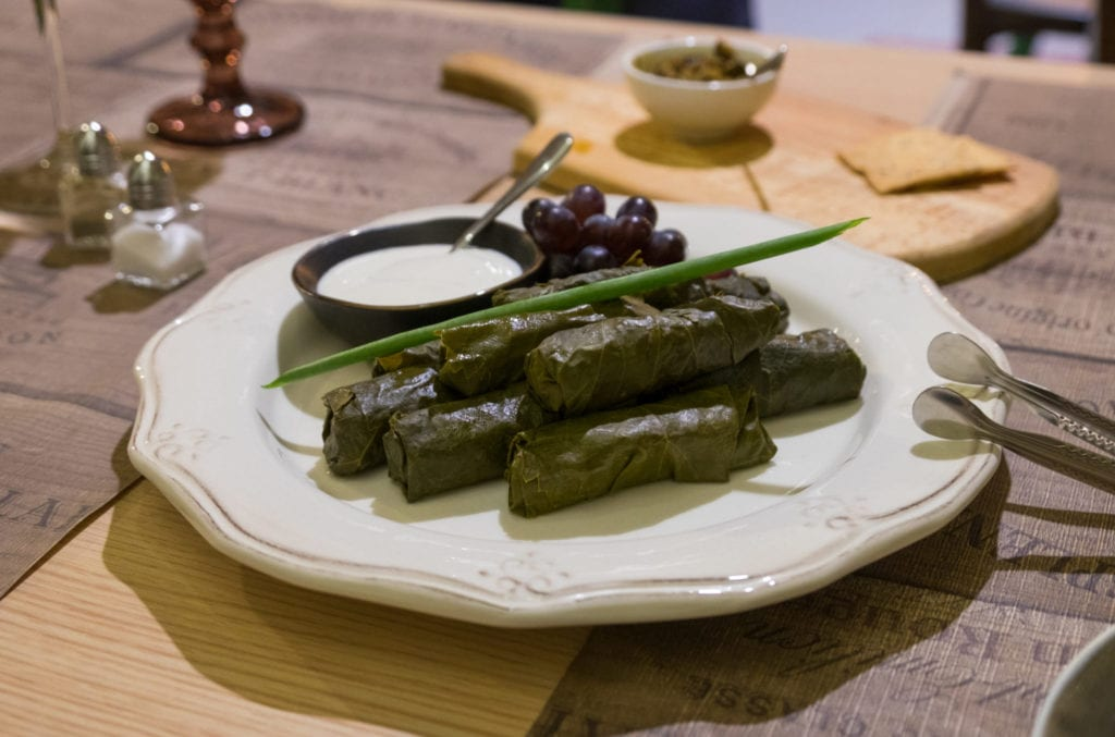A plate of dolma -- stuffed grape leaves -- on a plate.
