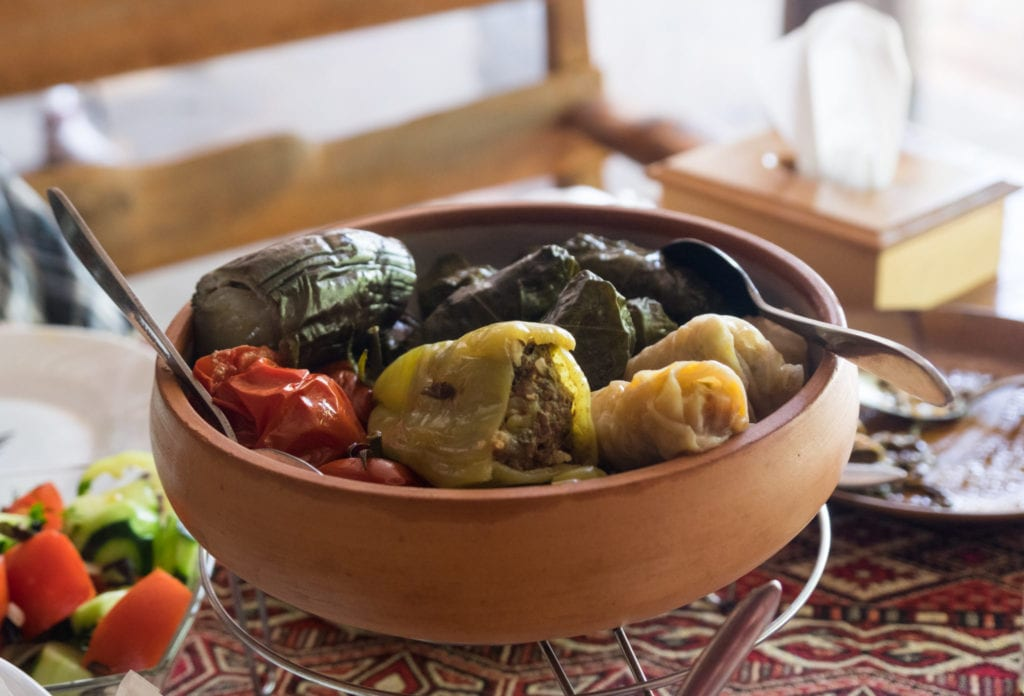 A clay pot filled with dolma, Armenian stuffed vegetables.