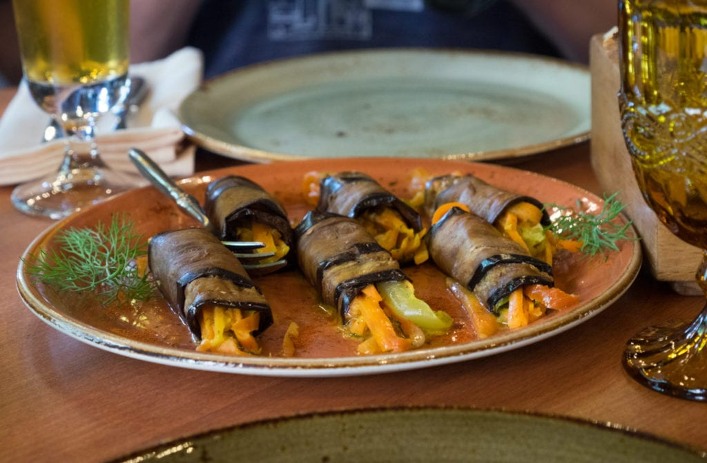 Rolled slices of eggplant stuffed with carrots and other vegetables.