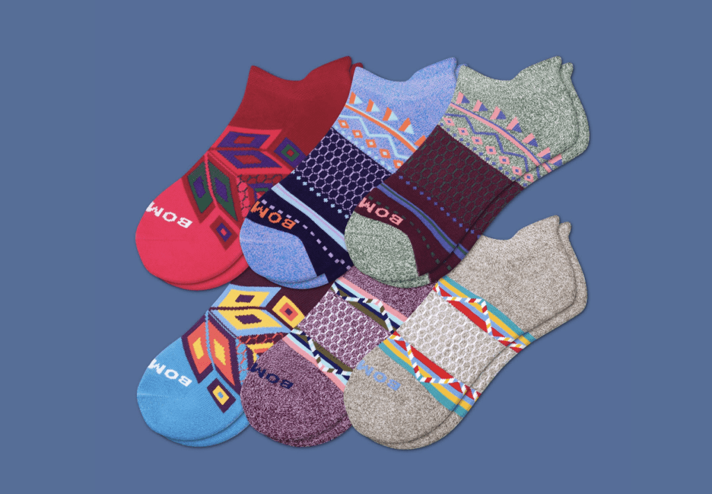 Six pairs of colorful Bombas ankle socks.