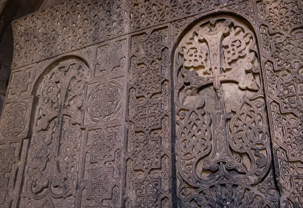 Ornate carvings on an Armenian monastery in the shape of crosses.