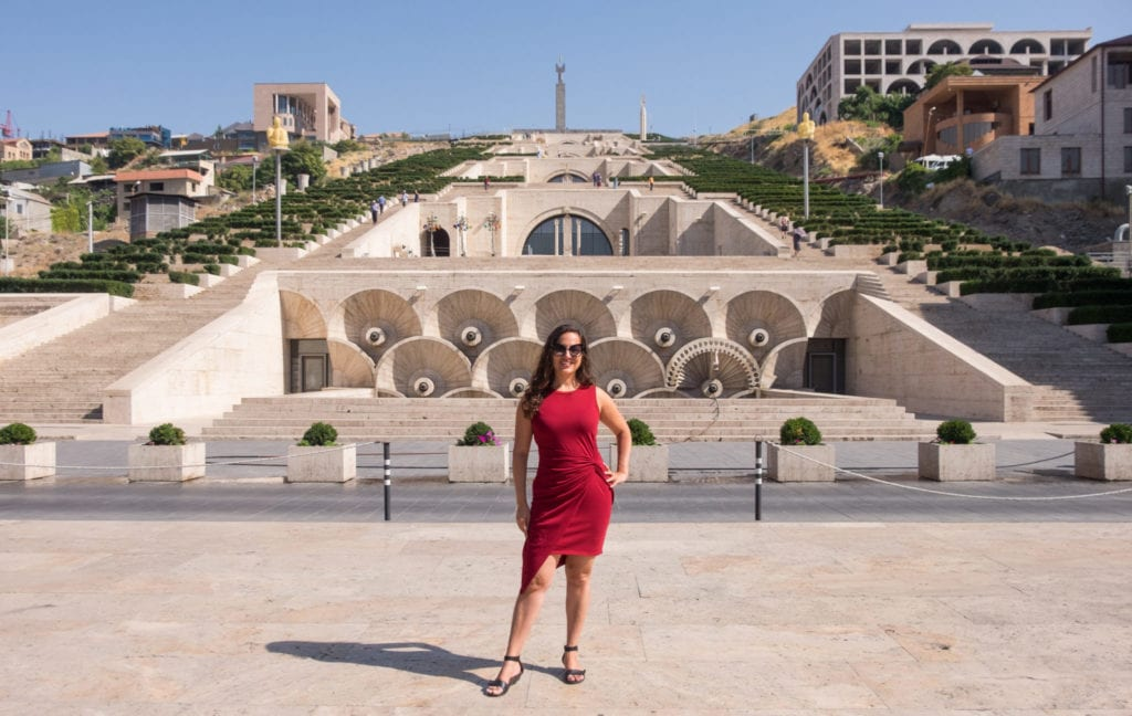 Kate stands in front of the pyramid-shaped Cascade building in Yerevan, Armenia.