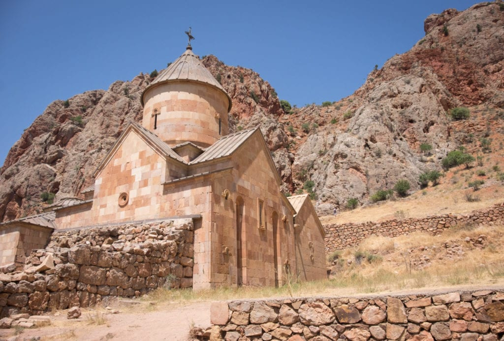 Noravank Monastery, the color of sand, surrounded by sand-colored mountains.