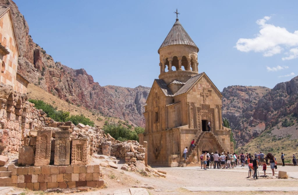 Noravank Monastery, a small sand-covered church surrounded by mountains.