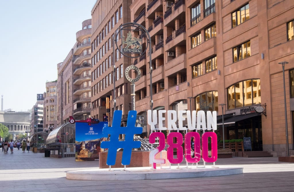 A pedestrian-only street with a large sign reading #Yerevan2800.