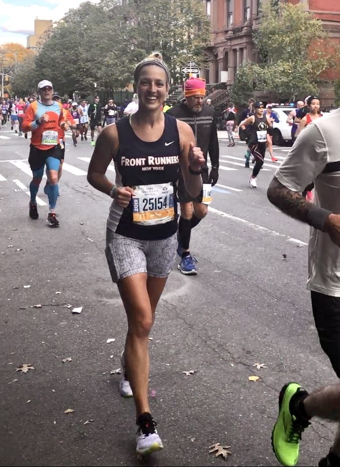 Kate's sister Sarah runs the New York marathon with a big smile on her face.