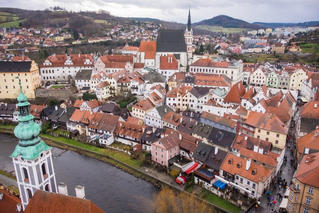 A view of the church towers and orange-roofed buildings of Cesky Krumlov