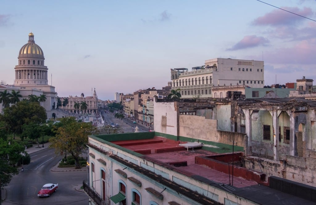 View of the Capitol building and the streets of Havana after sunset.