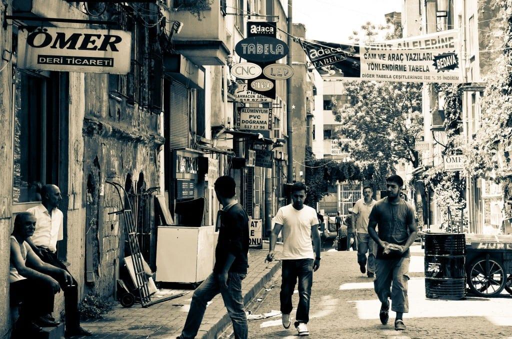Men walking down a busy street in Istanbul.