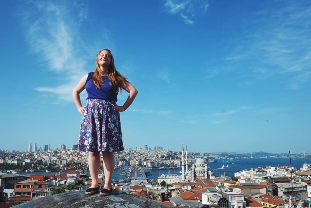 Katie standing on a rooftop in Istanbul underneath a blue sky.