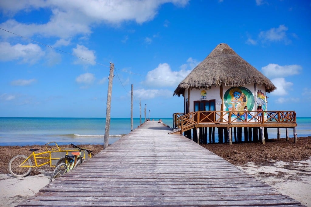 A hut and deck leading into the ocean at Holbox