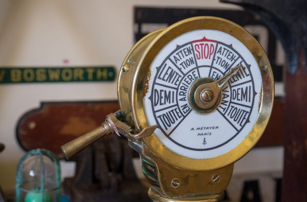 """A vintage ship navigation tool reading """"Toute, Demi, Lente, Attention and STOP!"""""""