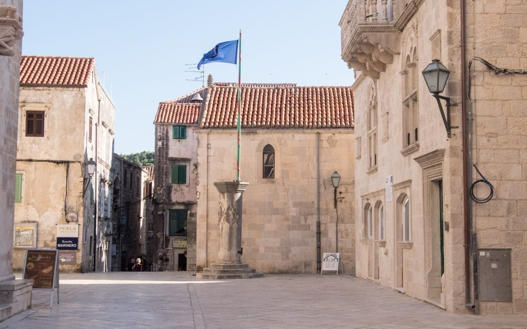 An empty stone piazza in Korcula's old town.