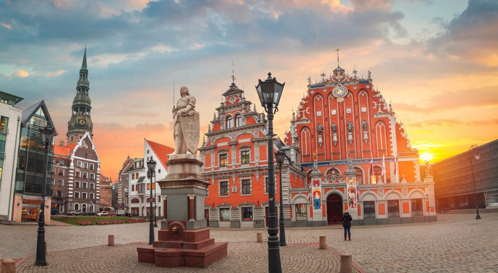 Triangular, pointy, crenellated, orangey-red buildings in Riga.