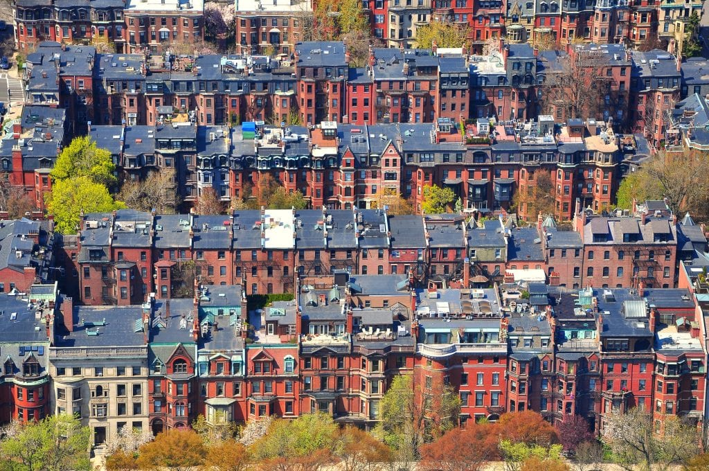 Rows and rows of brownstones in Back Bay shot from the air.