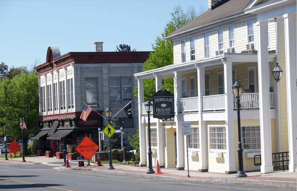 A small New England town with white columned buildings on a quiet street.