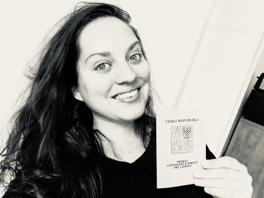 Kate holding up her little passport-like document that says Ceska Republika on top.