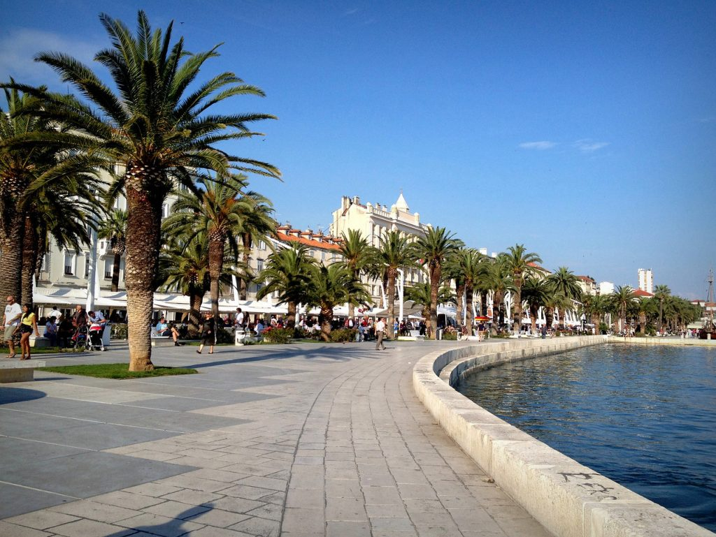 The Riva in Split: a stone boardwalk along the water, lined with palm trees.